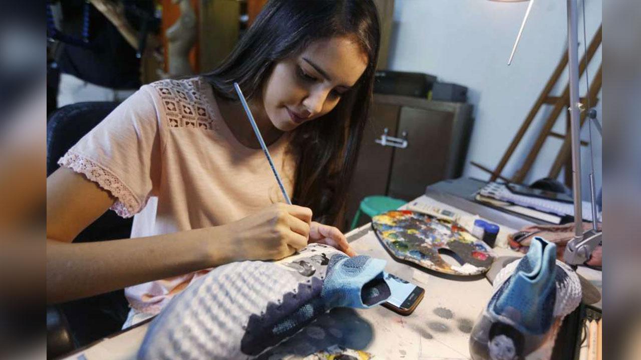 Vida de Messi plasmada en botines de artista paraguaya